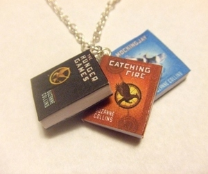 book, necklace, and hunger games image
