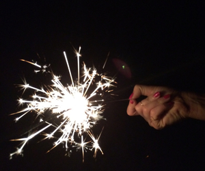 hand, night, and sparkler image