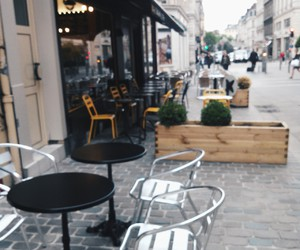 bar, chairs, and city image