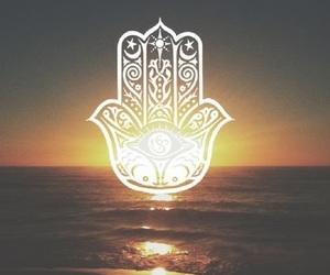 sunset, sun, and hamsa image