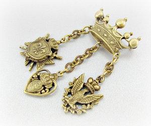 dangle brooch, vintage heraldic brooch, and brass crown brooch image