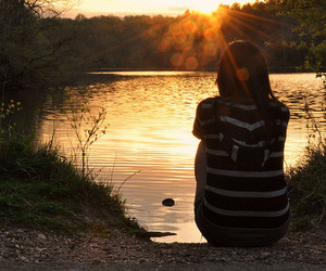 girl, sun, and water image