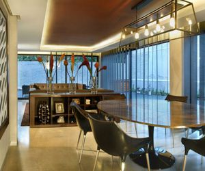modern dining area, rough concrete wall, and open floor concept image