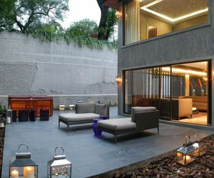 open floor concept, brown leather sofa, and modern exterior design image