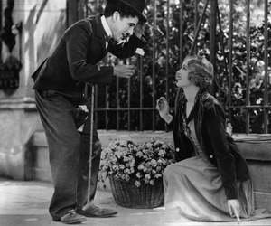 charlie chaplin, black and white, and flowers image