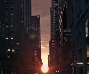 city, sunset, and sun image