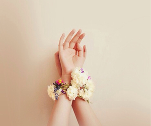 flowers, hands, and bracelet image
