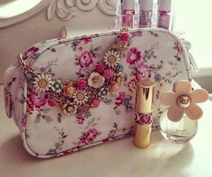 lipstick, makeup bag, and perfume image