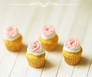 cupcakes and rose frosting image
