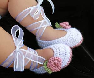 baby and shoes image