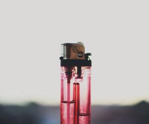 lighter, smoke, and red image