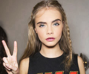 model, cara delevingne, and kiss image