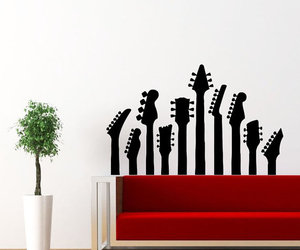 home decor, musical instrument, and wall decal image