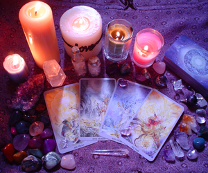 candles, crystals, and tarot cards image