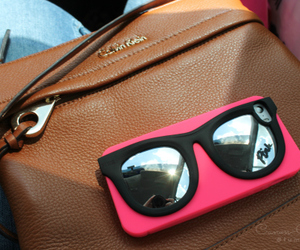 iphone and sunglasses image