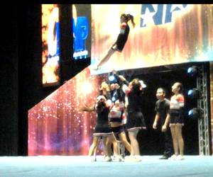 cheer, jaguars, and basket toss image