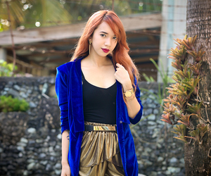 dark lipstick, blue blazer, and metallic shorts image