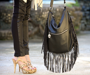 faux leather, fringe bag, and leather pants image