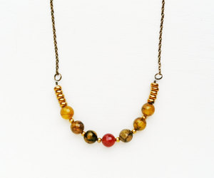 faceted, boho necklace, and geometric image