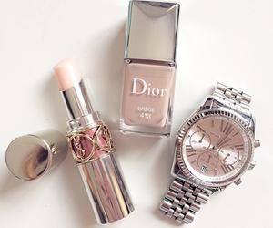 clock, lipstick, and nails image