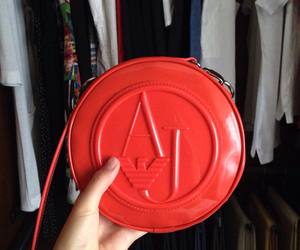 red bag and armani jeans image