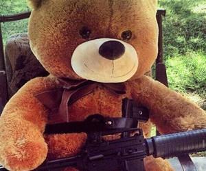guns and teddy image