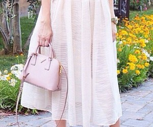 white blouse, light pink purse, and pink heels image