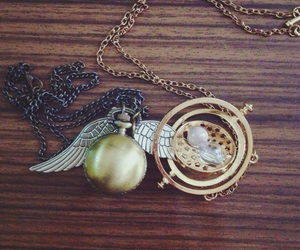 golden snitch, harry potter, and hermione granger image