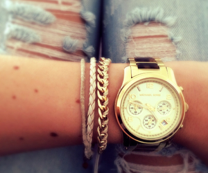 bracelet, Michael Kors, and ripped jeans image