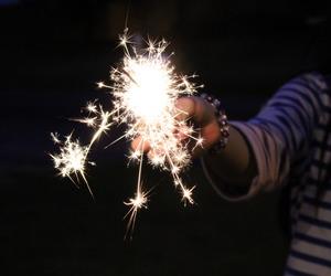 firework, sparkler, and stars image