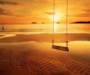 beach, sunset, and swing image