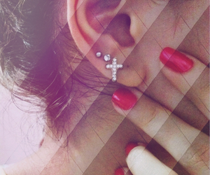 ear, piercing, and red image