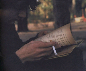 book, boy, and cigarette image