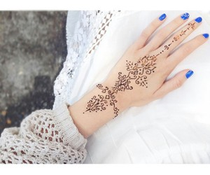 blue nails, white dress, and henna tattoos image