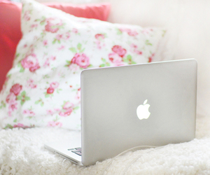 apple, laptop, and flowers image