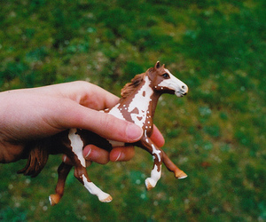 hand, horse, and toy image