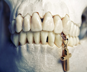 cross, skull, and teeth image