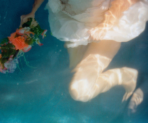 water, girl, and flowers image