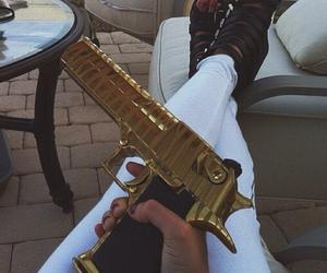 gun and gold image