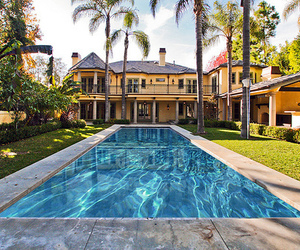 mansion, palm trees, and infinty pool image