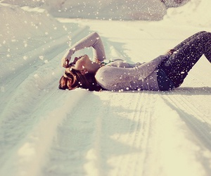 girl, winter, and lay down image
