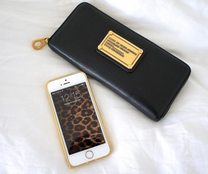 iphone, gold, and black image