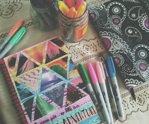 notebook, Sharpie, and art image