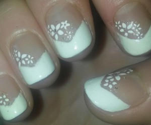 white flower nails and white tip nails image