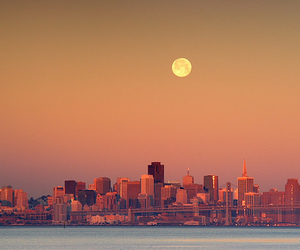 city, moon, and sun image