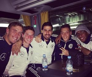 mesut Özil, sami khedira, and julian draxler image