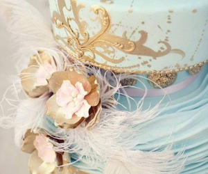 cake, feather, and gold image