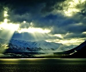 alaska, mountains, and sunrays image