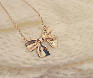 bow, gold, and necklace image