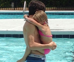 big brother, little sister, and swimming image